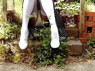 Milky Stockings And Satin Underpants In The Garden